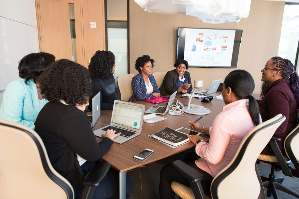 black women having meeting in upscale office