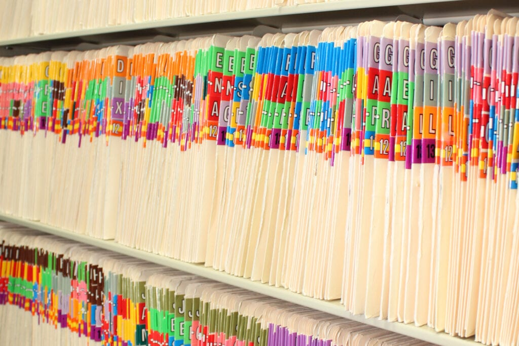 paper medical records in a cabinet